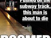 uomo cade sulle rotaie della metro fotografo scatta foto