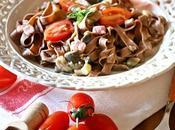 Tagliatelle cacao pomodorini, melanzane pancetta Cocoa tagliatelle with tomatoes, aubergine